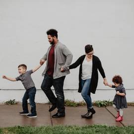 family-of-four-walking-at-the-street-2253879-min.jpg